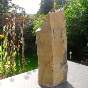 Basaltic Column Pet Memorial with Hand Carved Letters for Fifi in the Garden Side View