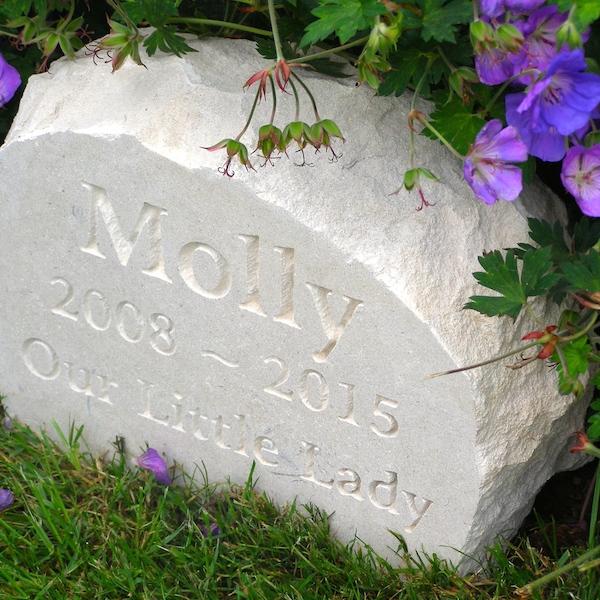 Pet memorials in stone. A limestone boulder pet memorial for Molly in the garden