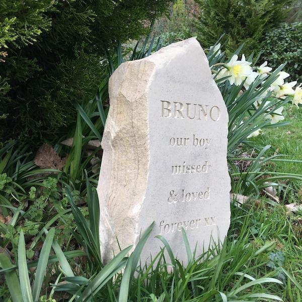 Pet Memorials in Stone. A Sandstone Standing Stone Pet Memorial for Bruno in the Garden