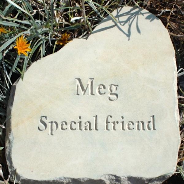 Pet Memorials in Stone. A Limestone Cloud Plaque Pet Memorial for Meg in the Garden