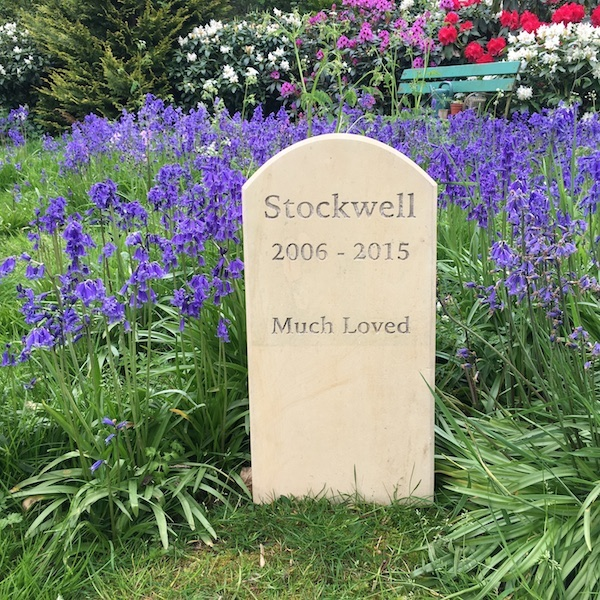 Pet Memorials in Stone. A Limestone Standing Stone Pet Memorial for Stockwell in the Garden