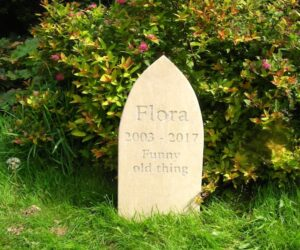 limestone gothic style standing stone pet memorial for flora in the gardens natural unpainted inscription