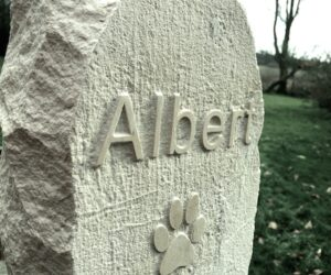 limestone standing stone pet memorial with letters and paw print in relief for albert