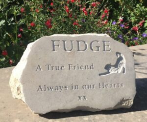 limestone pet memorial boulder with stretching cat motif for fudge