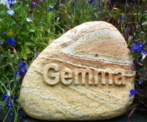 rainbow cobble pet memorial with letters in relief for Gemma