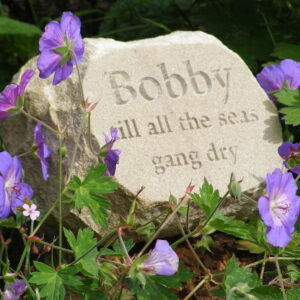 Sandstone Pet Memorial Boulder for Bobby in the Garden amongst the Geraniums