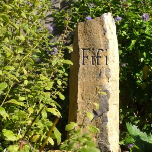 Basaltic Column Pet Memorial with Hand Carved Letters for Fifi Trixabelle in the Garden