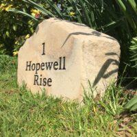 House sign boulder sandstone Hopewell